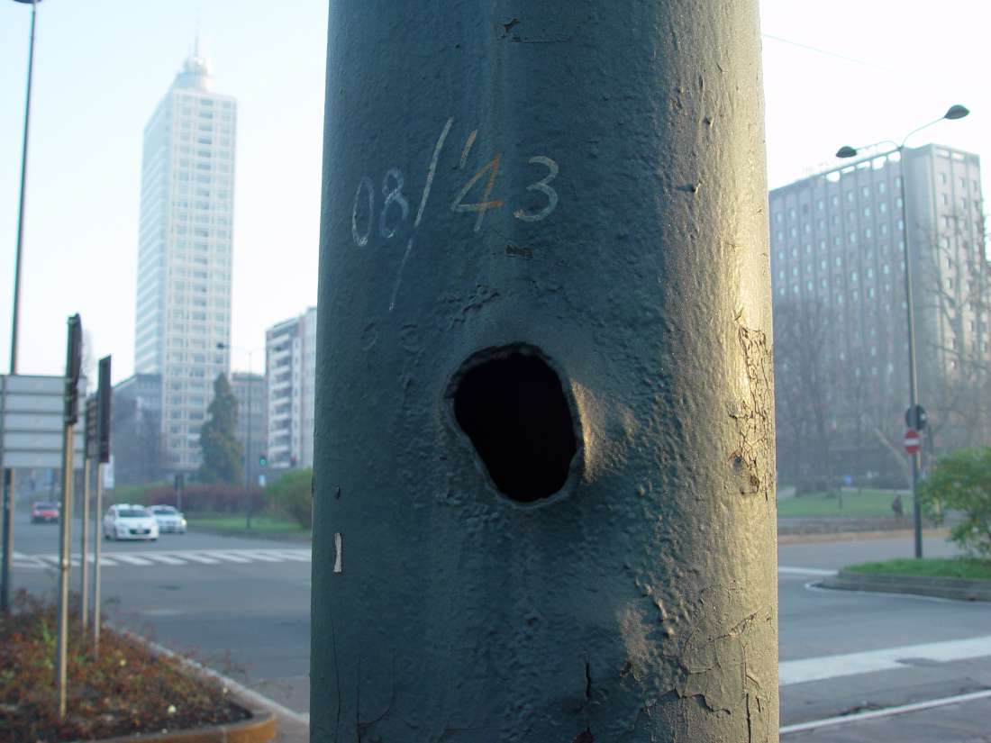 Piazza della Repubblica, silent testimony to the Second World War. The shrapnel hole in the lamp-post has been dated